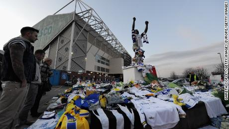 Fans pay tribute to former Leeds United player Gary Speed in 2011 outside the club's Elland Road stadium.