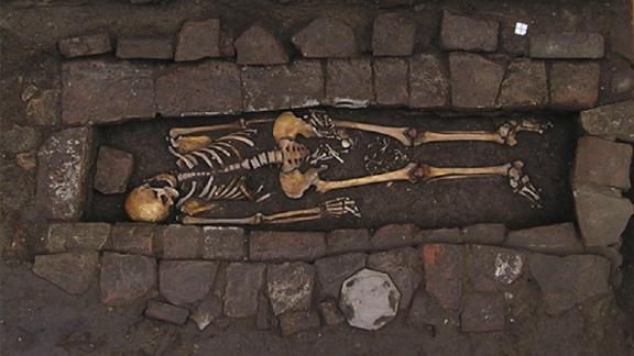 "The skeleton of a young woman and her fetus were found in a brick coffin dated to medieval Italy. Her skull shows an example of neurosurgery, and her child was extruded after death in a rare ""coffin birth."""
