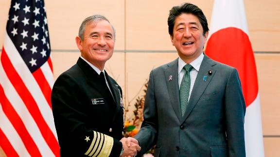 Harry Harris shakes hands with Japanese Prime Minister Shinzo Abe at the prime minister's official residence in Tokyo on November 16.