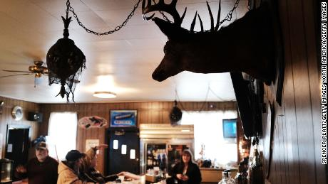 WAYNESBURG, PA - MARCH 01: A deer head hangs on the wall of a bar outside of Waynesburg near the West Virginia border on March 1, 2018 in Waynesburg, Pennsylvania. Waynesburg, once a thriving coal industry center, has struggled to find its footing in the new energy era. The average household income in the city is $38,255, more than $15,000 a year below the state average and another area coal mine is set to start closing down on March 2nd. Despite President Donald Trump's pledge to bring back the coal industry, some 370 coal miners are expected to lose their jobs at the 4 West Mine in southwestern Pennsylvania when it closes. Following the first wave of layoffs the remaining 175 miners will be let go by June 1 after the company removes underground equipment and seals the mine. ((Photo by Spencer Platt/Getty Images)