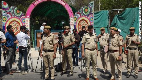 Indian policemen stand guard outside the ashram of controversial Indian guru Asaram Bapu on April 25, 2018.