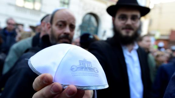 A man shows a kippa during the rally in Berlin.