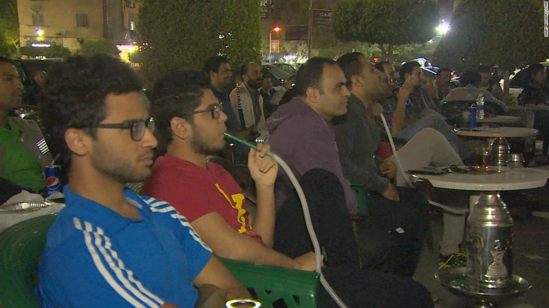 Fans in an Al Nasr City cafe watch on as Salah plays for Liverpool in the Champions League.