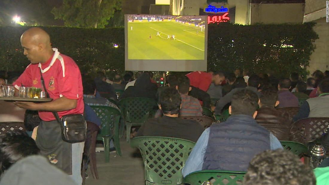 The café is full of people watching Liverpool in the Champions League.