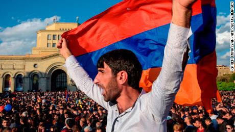 People celebrate Armenian prime minister Serzh Sarkisian's resignation in downtown Yerevan on April 23, 2018. - Armenia's veteran leader Serzh Sarkisian resigned on April 23, 2018 after mass protests against his election as prime minister, sparking jubilant celebrations across the impoverished country. (Photo by KAREN MINASYAN / AFP)        (Photo credit should read KAREN MINASYAN/AFP/Getty Images)