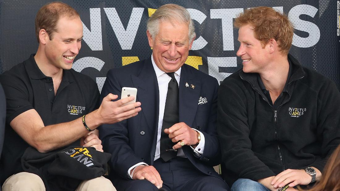 Harry and his older brother William share a joke with their father Charles during the Invictus Games in 2014. London, UK, September 2014.