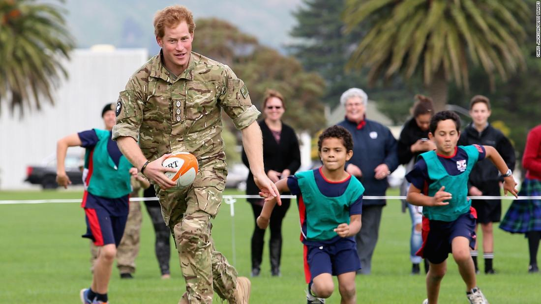 Harry plays touch rugby with schoolchildren during a trip to New Zealand. Palmerston North, New Zealand, May 2015.