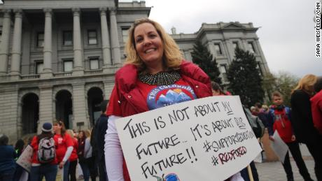 Sharon Roybal rallies with her colleagues at the Colorado Capitol in Denver on April 26, 2018.