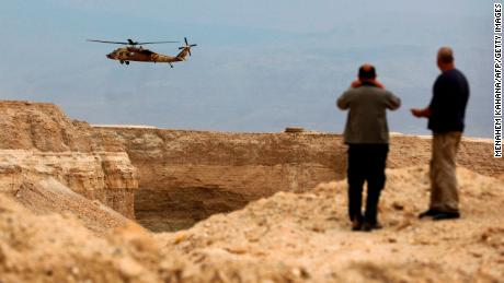 An Israeli military helicopter takes part in the search mission Thursday in southern Israel.
