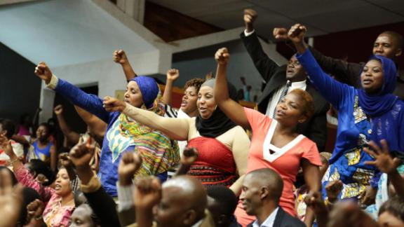Rwandan people react during the Constitution amendment debate at the parliament in Kigali in 2015 that allowed Paul Kagame a third term in power as president. Rwanda has the highest percentage of women (61%) in its parliament in the world.
