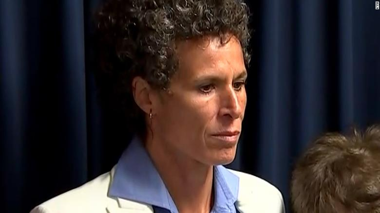 Andrea Constand stands at a press conference after Bill Cosby was found guilty on April 26, 2018.