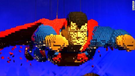 VIDEO SHOWS: LEGO SUPERMAN / SUPERHERO LEGO FIGURES / LEGO ARTIST, NATHAN SAWAYA, SAYING HOW HE BUILDS HIS LEGO FIGURES, HE LEFT HIS JOB AS A LAWYER TO BUILD LEGO ART TO BE HAPPY AND EVERYONE CAN CONNECT TO LEGO BECAUSE EVERYONE CAN SNAP A FEW BRICKS TOGETHER, HE BUILT SUPERHEORES BECAUSE HE WANTED TO EXPLORE GOOD AND EVIL AND PLAY WITH THE SUPERHEORES HE ADMIRED AS A CHILD ON A BIGGER SCALE / LEGO BATMAN / LEGO BATMOBILE / LEGO COMIC BOOK COVERS / LEGO WONDER WOMAN / LEGO CATWOMAN