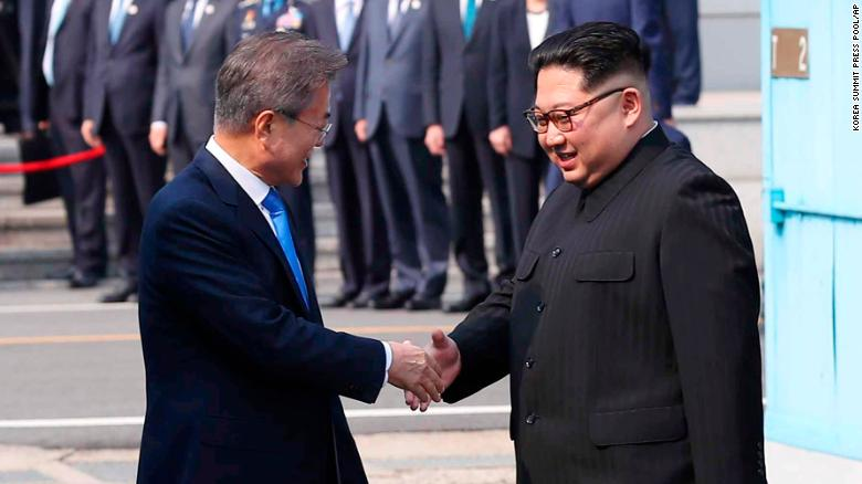 North Korean leader Kim Jong Un, right, shakes hands with South Korean President Moon Jae-in Friday.