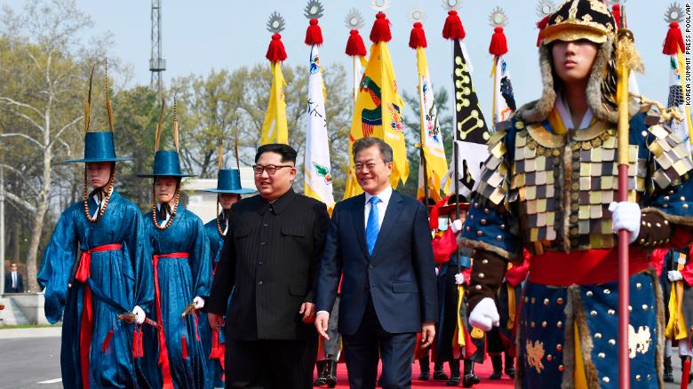 North Korean leader Kim Jong Un, left, and South Korean President Moon Jae-in walk together at the border village of Panmunjom Friday.