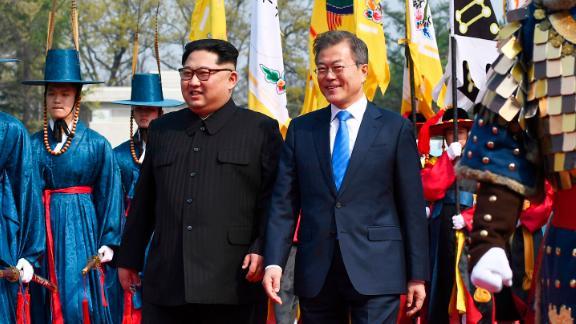North Korean leader Kim Jong Un, left, and South Korean President Moon Jae-in walk together at the border village of Panmunjom Friday.