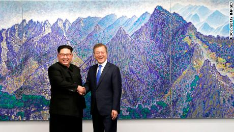 Kim and Moon Jae-in pose for photos in front of Bukhansan Peace House for the Inter-Korean Summit on April 27.