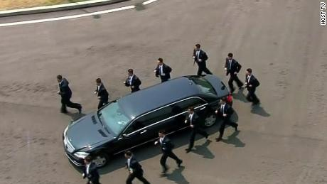 See Kim's security guards run alongside limo