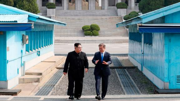 North Korean leader Kim Jong Un, left, listens to South Korean President Moon Jae-in while walking together at the Panmunjom in the Demilitarized Zone Friday, April 27, 2018. Kim made history Friday by crossing over the world's most heavily armed border to greet his rival, Moon, for talks on North Korea's nuclear weapons. (Korea Summit Press Pool via AP)