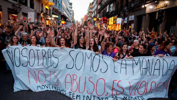 """Protesters in Madrid carry a sign reading 'We are the wolf pack. It not abuse, it is rape"""" during a demonstration against the verdict in April."""