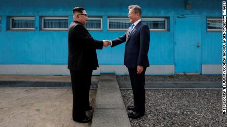 SEOUL, SOUTH KOREA - APRIL 27: South Korean President Moon Jae-in (R) and North Korean leader Kim Jong-un (L) meet at the Military Demarcation Line of the truce village of Panmunjom, South Korea on April 27, 2018. Kim Jong-un is the first North Korean leader to enter South Korea since the end of the Korean War in 1953. (Photo by Inter-Korean Summit / POOL/Anadolu Agency/Getty Images)