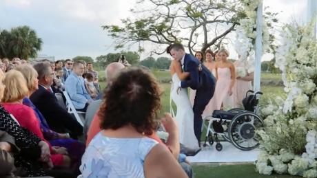 Emily Summers helped Chris Norton, who'd been paralyzed in a football accident, walk down the aisle during their April 2018 wedding.