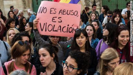 "A woman protests Thursday in Alicante, Spain, with a placard that reads: ""It is not abuse, it is rape."""