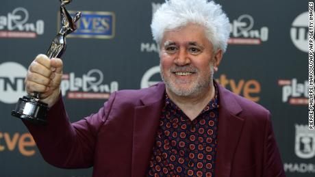 "Spanish director Pedro Almodovar displays his trophy for Best Direction during the 4th edition of the ""Premios Platino"" for Ibero-American Cinema awards ceremony in Madrid on July 22, 2017. / AFP PHOTO / PIERRE-PHILIPPE MARCOU        (Photo credit should read PIERRE-PHILIPPE MARCOU/AFP/Getty Images)"