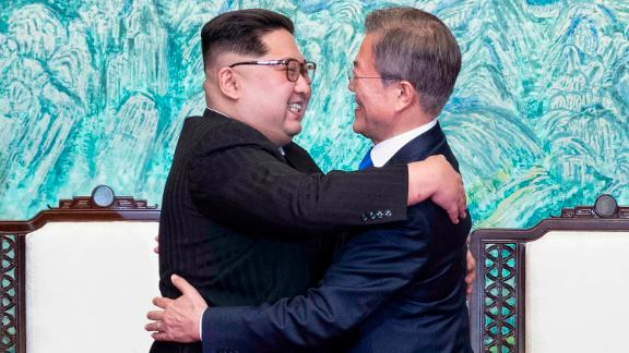 North Korean leader Kim Jong Un, left, and South Korean President Moon Jae-in embrace each other after signing on a joint statement at the border village of Panmunjom in the Demilitarized Zone, South Korea, Friday, April 27, 2018. (Korea Summit Press Pool via AP)