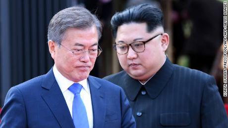 "North Korea's leader Kim Jong Un (L) and South Korea's President Moon Jae-in (R) walk to announce a joint statement after a signing ceremony near the end of their historic summit at the truce village of Panmunjom on April 27, 2018. - The leaders of the two Koreas held a landmark summit on April 27 after a highly symbolic handshake over the Military Demarcation Line that divides their countries, with the North's Kim Jong Un declaring they were at the ""threshold of a new history"". (Photo by Korea Summit Press Pool / Korea Summit Press Pool / AFP)        (Photo credit should read KOREA SUMMIT PRESS POOL/AFP/Getty Images)"