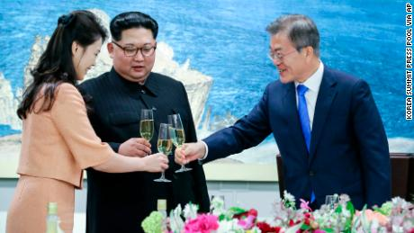 South Korean President Moon Jae-in, right, toasts Ri Sol Ju, wife of North Korean leader Kim Jong Un at a banquet that concluded the summit.