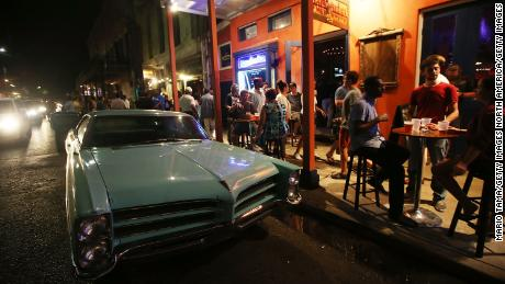 NEW ORLEANS, LA - AUGUST 21:  People gather at a music club on Frenchmen Street, a live music area traditionally known by locals but now popular with tourists, on August 21, 2015 in New Orleans, Louisiana. The tourism industry has rebounded strongly in the city following Katrina and last year the city had nearly as many visitors as the year before the storm. The tenth anniversary of Hurricane Katrina, which killed at least 1836 and is considered the costliest natural disaster in U.S. history, is August 29.  (Photo by Mario Tama/Getty Images)