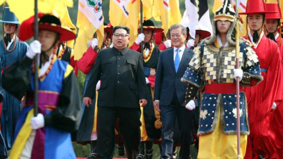 North Korea's leader Kim Jong Un (L) walks with South Korea's President Moon Jae-in (R) down a red carpet during a welcoming ceremony to the official summit Peace House building ahead of their meeting at Panmunjom on April 27, 2018. - North Korean leader Kim Jong Un and the South's President Moon Jae-in sat down to a historic summit Friday after shaking hands over the Military Demarcation Line that divides their countries in a gesture laden with symbolism. (Photo by Korea Summit Press Pool / Korea Summit Press Pool / AFP)        (Photo credit should read KOREA SUMMIT PRESS POOL/AFP/Getty Images)