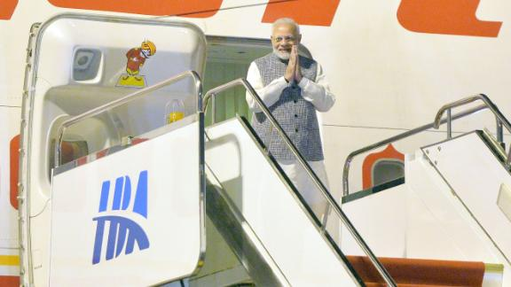 Indian Prime Minister Narendra Modi exits his plane after arriving in Wuhan in China