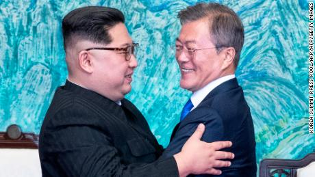 "North Korea's leader Kim Jong Un (L) and South Korea's President Moon Jae-in (R) hug during a signing ceremony near the end of their historic summit at the truce village of Panmunjom on April 27, 2018. - The leaders of South and North Korea embraced warmly after signing a statement in which they declared ""there will be no more war on the Korean Peninsula"". (Photo by Korea Summit Press Pool / Korea Summit Press Pool / AFP)        (Photo credit should read KOREA SUMMIT PRESS POOL/AFP/Getty Images)"