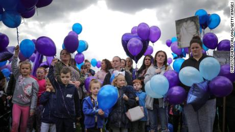 People prepare to release balloons in memory of Alfie Evans.