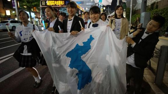 Koreans in Japan celebrate the  summit in a rally Friday.