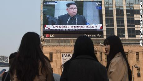 A big screen in Seoul shows live footage of Kim and Moon's joint news conference Friday.