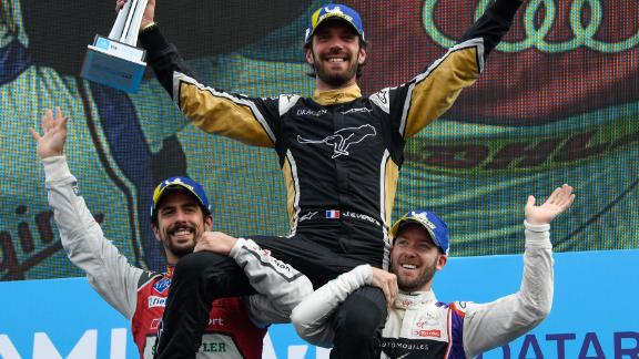 Vergne was hoisted by runner-up Lucas di Grassi (left) and Bird after winning the Paris ePrix.