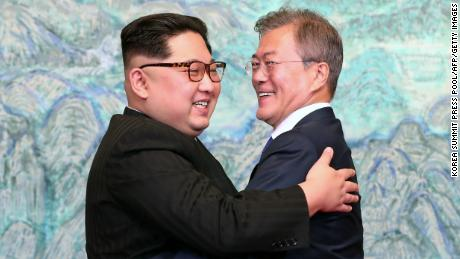 "TOPSHOT - North Korea's leader Kim Jong Un (L) and South Korea's President Moon Jae-in (R) hug during a signing ceremony near the end of their historic summit at the truce village of Panmunjom on April 27, 2018. - The leaders of the two Koreas held a landmark summit on April 27 after a highly symbolic handshake over the Military Demarcation Line that divides their countries, with the North's Kim Jong Un declaring they were at the ""threshold of a new history"". (Photo by Korea Summit Press Pool / Korea Summit Press Pool / AFP)        (Photo credit should read KOREA SUMMIT PRESS POOL/AFP/Getty Images)"