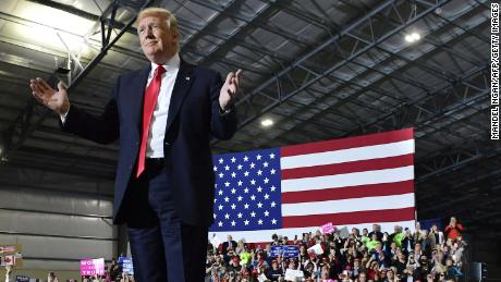 US President Donald Trump speaks during a rally at Total Sports Park in Washington, Michigan on April 28, 2018. (Photo by MANDEL NGAN / AFP)        (Photo credit should read MANDEL NGAN/AFP/Getty Images)