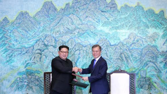 North Korean leader Kim Jong Un (left) and South Korean President Moon Jae-in (right) pose for photographs after signing the Panmunjom Declaration.