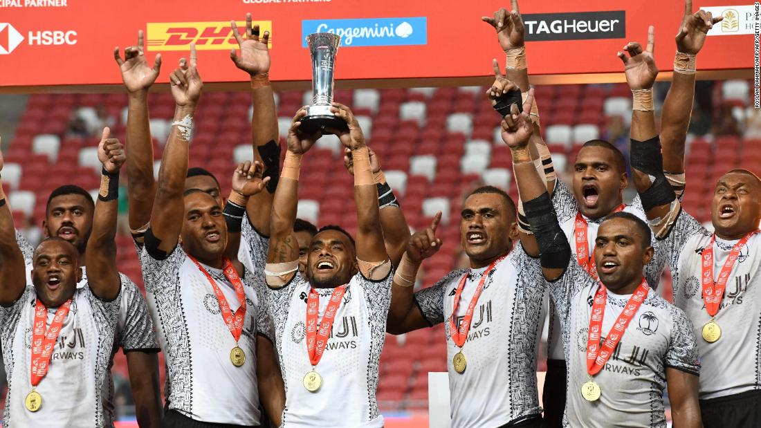 Fiji moved to the top of the standings with a tense victory over Australia in Singapore.