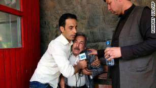 A man cries after his son was killed in an ISIS attack in Kabul, Afghanistan, Monday, April 30.