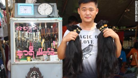 A hair buyer from China with bunches of hair he has bought from Yangon's Insein market.