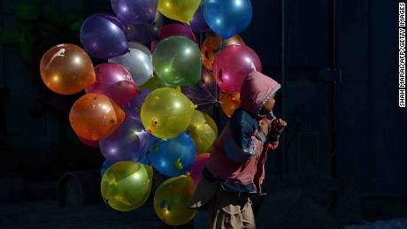 An Afghan boy sells balloons in Kabul in 2013.