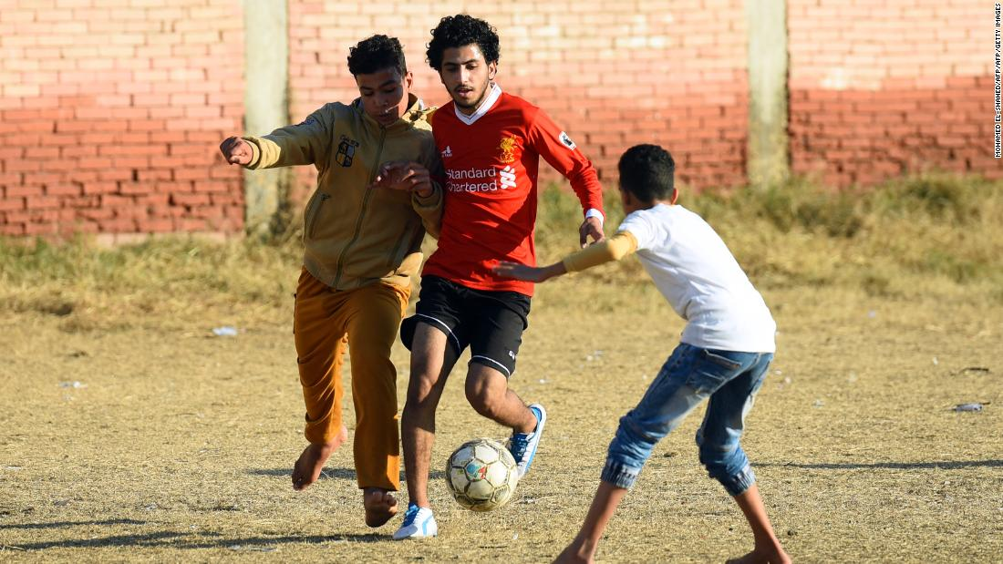 Egyptian boys play football at the Mohamed Salah Youth Center in the Egyptian village of Nagrig, about 120 kilometers northwest of Cairo.