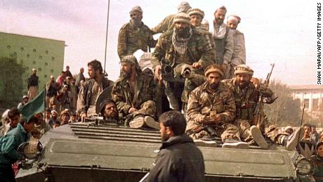 Security forces from the Northern Alliance enter Kabul on November, 13, 2001.