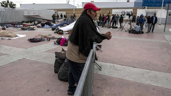 """Central American migrants travelling in the """"Migrant Via Crucis"""" wait to be received by US authorities outside """"El Chaparral"""" port of entry to US, in Tijuana, Baja California State, Mexico on April 30, 2018. - According to the U.S. Customs and Border Protection on Sunday, none of the migrants from the caravan was processed for asylum because the agency had reached capacity for the day for migrants seeking asylum. At least 150 Central American migrants reached the border between Mexico and the United States on Sunday, determined to seek asylum from the US. The group arrived in the Mexican border town of Tijuana, part of a caravan of more than 1,000 people who set out from Mexico's southern border on March 25. (Photo by GUILLERMO ARIAS / AFP)        (Photo credit should read GUILLERMO ARIAS/AFP/Getty Images)"""