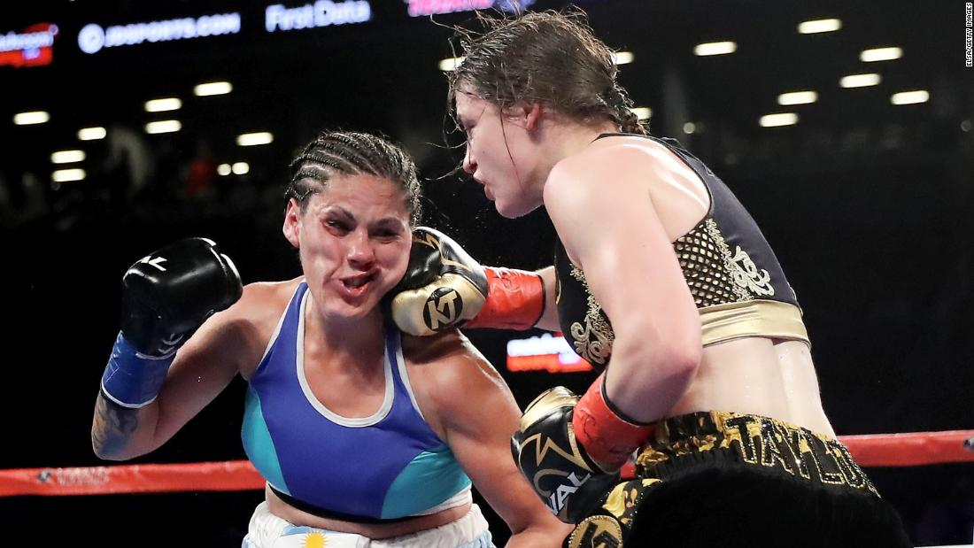Katie Taylor punches Victoria Bustos during a lightweight title fight in New York on Saturday, April 28. Taylor won by unanimous decision, unifying the WBA and IBF titles.