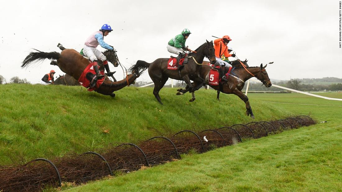 A horse falls during a steeplechase race in Naas, Ireland, on Tuesday, April 24.
